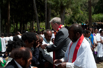 Photo: Rev. Dr. Tim Quill distributing communion.