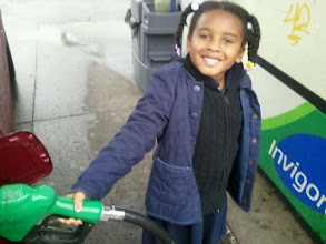 Photo: Kaleya pumps gas (or pretends to) :-)