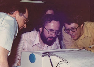 Photo: l to r: Henry Ewasechko (UQV), Mike Alexander (UM) and Gerry Gabel (UQV) at the 1052 console on an Amdahl 470V/6 at the Amdahl Benchmarking Center, Sunnyvale, CA, USA, fall 1974