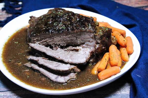 Slices Of 4 Ingredient Fix It And Forget It Chuck Roast With Gravy.