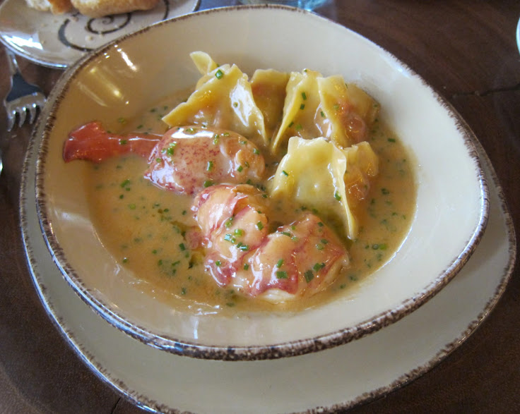 The Lobster Ravioli: lobster and mascarpone stuffed pasta drowning in buttery sauce with a whole split lobster tail at its side. Photo: Mike U from Endoedibles.