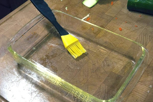 Brush some olive oil on the bottom of a baking dish.