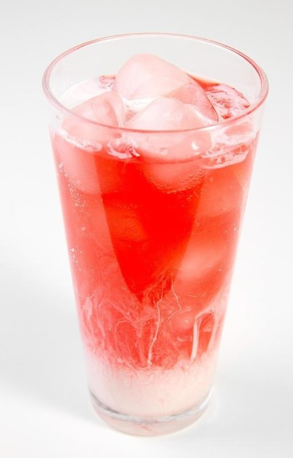 Mix together your sparkling soda and flavor syrups with ice. Drizzle a bit of...