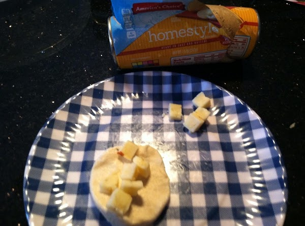 IN EACH FLATTEND BISCUIT PLACE 3-4 (OR MORE) CUBES OF MONT JACK CHEESE N...