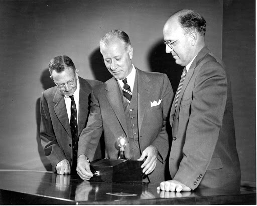 Dr. William D. Coolidge, GE President Ralph Cordiner, and C. Guy Suits examine the 100-year light at the GE Research Laboratory