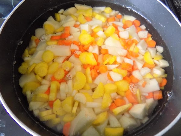 Bring to a boil. Cook until potatoes are soft enough for a fork to...
