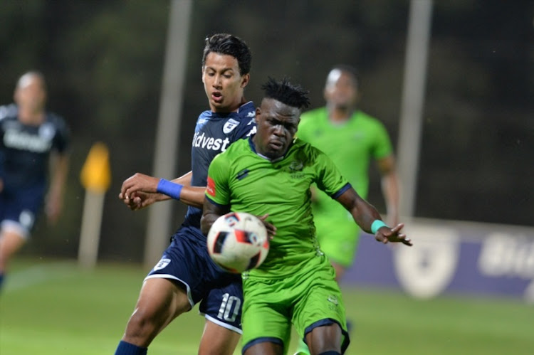 JOHANNESBURG, SOUTH AFRICA - DECEMBER 16: Siyabonga Zulu of Platinum Stars and Amr Gamal of Bidvest Wits during the Absa Premiership match between Bidvest Wits and Platinum Stars at Bidvest Stadium on December 16, 2017 in Johannesburg, South Africa.