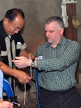 Photo: Jack gets his wrist tied while shaman chants New Year wishes