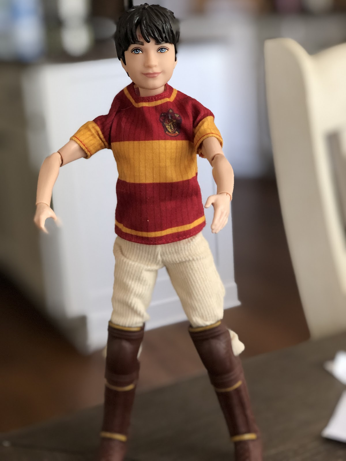 A Harry Potter action figure standing on a table.