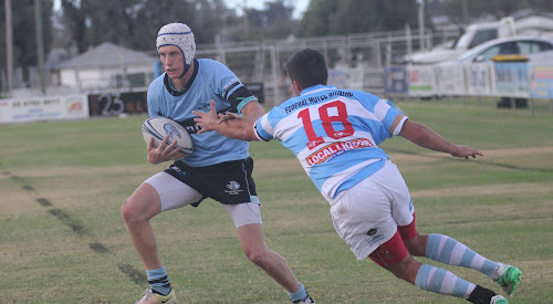 Narrabri's Linton Grumley cruises past a Quirindi defender on his way to his first try.