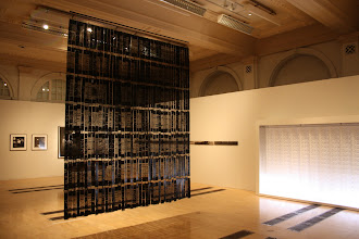 Photo: Suzumi Noda's piece on the left made of lacquered Japanese jacquard loom punch cards.