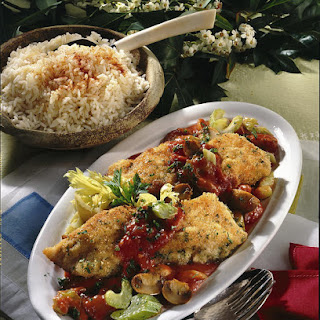 Breaded Fish with Tomato and Mushroom Sauce.