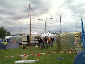 Photo: austrians with radio antenna and golden art cube