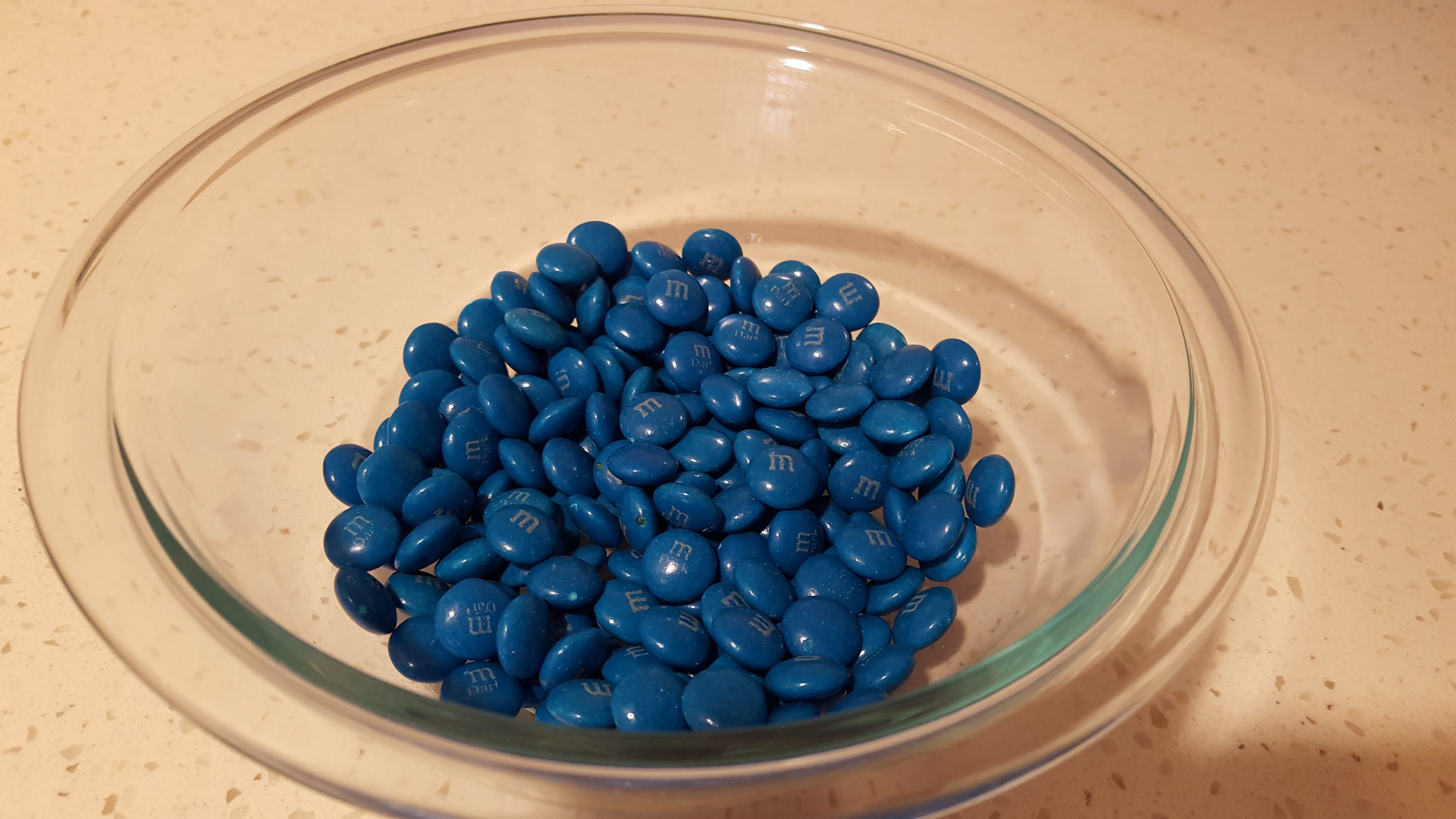 bowl of blue dark chocolate m&ms
