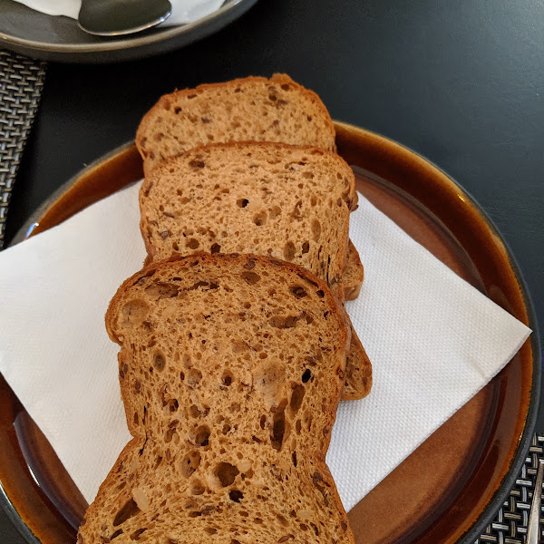 August 4, 2019. They brought two baskets of bread to our table: one regular and these slices, which are GF!