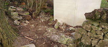 Dry stone wall rebuild in progress in Bath