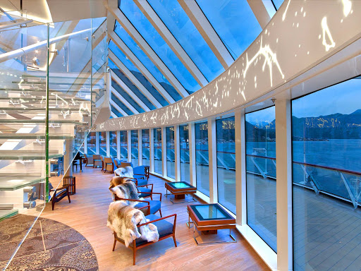Explorers-Lounge-Windows-Stairs-Night.jpg - The two-story Explorers Lounge on a Viking ocean ship is the perfect place to watch the twilight in an exotic destination.