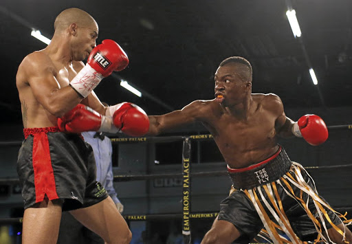 "Rofhiwa ""Tsetse Fly"" Nemushungwa, right, tries to land a jab on Joshua ""TKO"" Studdard during their 10-rounder which Nemushungwa won on a split points decision on Monday."