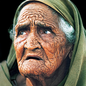 Anguish by Sami Ur Rahman - People Portraits of Women ( expression, pain, face lines, old woman, green headcover,  )