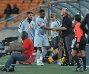 A visibly disappointed Itumeleng Khune limps off the pitch with a suspected injury.