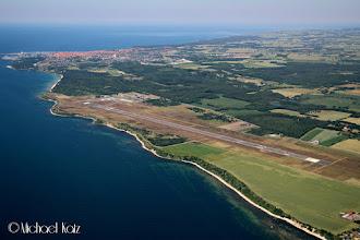 Photo: Bornholm Lufthavn med Rønne oppe til venstre