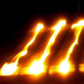 Flames - Seven by Shankara Narayanan - Abstract Fire & Fireworks ( flames, seven, lamp, yellow, light )