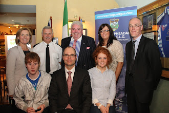 Photo: Back row l-r Katrian kernan Pointer Group, Stanley Lutton South Down Neighbour Officer, Feargal McCormack Chairman St Peters GAA, Aisling McGivern Pointer Group, Eoin Magennis secretary, front row  two representatives from the Pointer Group Paul Boylan and Katy Grant meet US Consul Greg Burton.