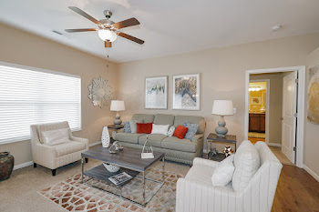Sydney living room with couch and chairs and ceiling fan