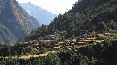 Photo: The Budhi Gandaki enters a gorge.  The occassional villages are set on small ledges like this, but mostly the track is in forest with the thundering river far below.