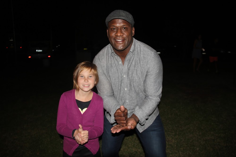 Tanesha Lang and Wendell Sailor give a 'that's gold' to men's health in Wee Waa on Thursday night.