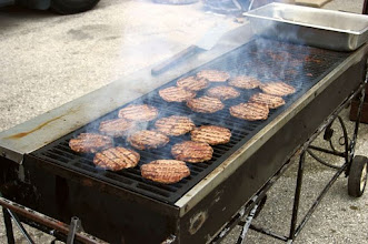 Photo: Large Grill on wheels with Hamburgers