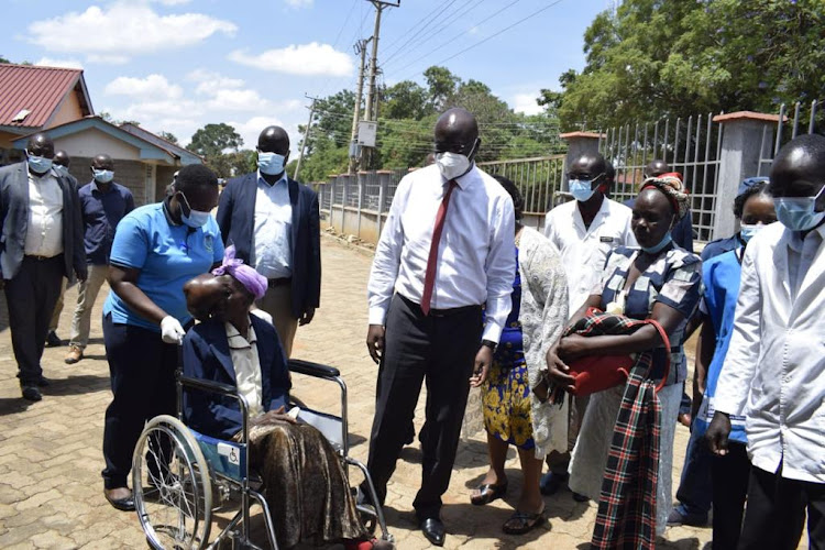 Beatrice on arrival at the Bungoma Level 5 Hospital on Sunday. Right is Governor Wycliffe Wangamati.