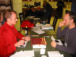 Photo: Sam Payne vs. Urban Larsson in a game of Bidding Chess.