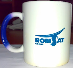 "Photo: Чашка ""хамелеон"" с логотипом Romsat Group. На фотографии - горячая чашка"