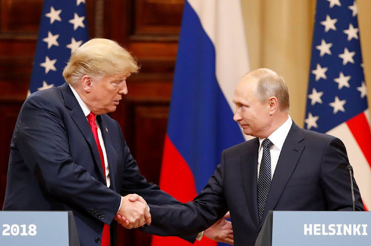 Trade off: US President Donald Trump and Russian President Vladimir Putin after their meeting in Helsinki on Monday. Trump refused to blame Putin for meddling in the 2016 elections, casting doubt on the findings of US intelligence agencies and sparking a storm of criticism. Picture: REUTERS