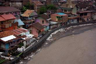 Photo: River running through Yogyakarta city; note the sandbags and fortification to stop the flooding