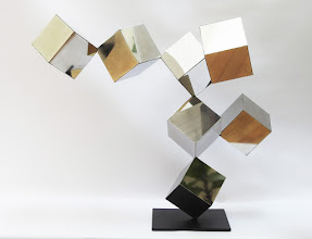 Photo: 42 REFLECTIONS - 33H X 40W X 25D Polished Stainless Steel, Painted Mild Steel, Front View
