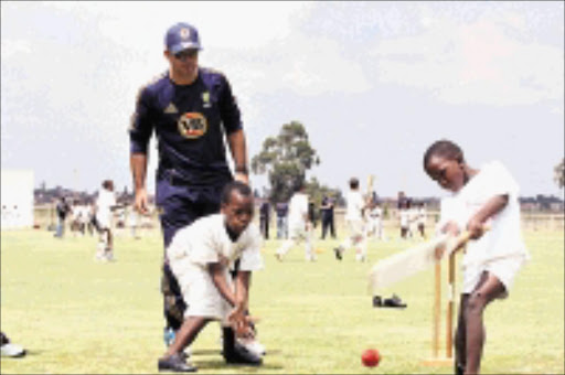 COVER DRIVE: Australia cricket captain Ricky Ponting watches Buyani Ngcobo and Ntokozo Mazibuko from Uvuyo Primary School in Soweto go through their paces. 23/02/2009. © Sowetan. Pic. Bafana Mahlangu.