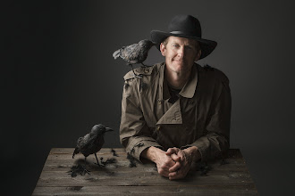 Photo: The Raven Whisperer  I had a shoot planned with Eric today. I had no idea he was so passionate about ravens. In fact, the name of his company is The Raven Workshop! The timing could not have been more perfect. I just happened to have two ravens on loan in the studio :)  I always say that I need just one great image to consider a shoot a success. I definitely got more than one from this shoot, but if all I got was this one, I would be ecstatic, nonetheless. Because it doesn't just tell a story, it tells a REAL story...  Lighting info: - AlienBee B800 in med. soft box, camera left at aprox. 30 degree angle - AlienBee B800 in med. octabox behind camera, up high, for fill - AlienBee B800 with 40 degree grid behind subject, aimed at Thunder Grey seamless background  Canon 5d Mkll Canon 24-105mm 'L' Lens F/11 - 125th sec. - 125 ISO Photoshop CS6