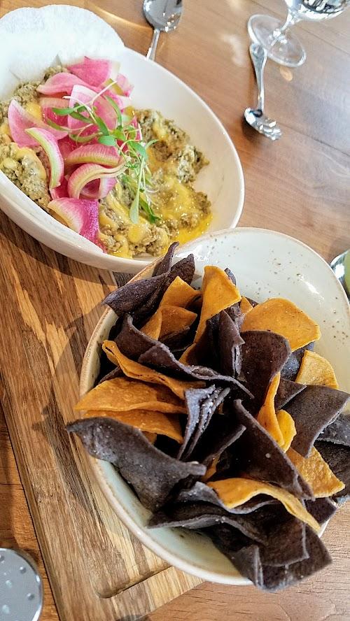 Alto Bajo Bocadito (small plate) of Sikil Pak is vegan and gluten free. Sikil Pak is a Mayan pumpkin dip with habenro, garlic, grapefruit juice.