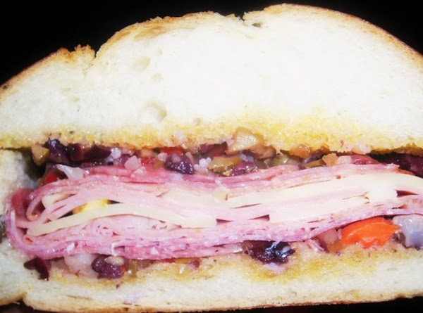 muffaletta: pork meats, cheese, olive tapenade