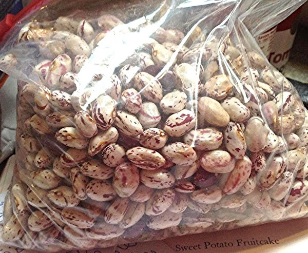 Pick through beans for debris, and other foreign particles, then wash & drain.