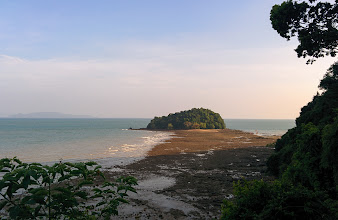 Photo: Sand bar and islet at low tide during golden hour.