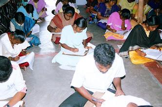 Photo: Both boys and girls writing their examination