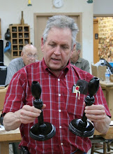 Photo: Bill Autry completed this pair of ebonized african utile (sipo) multiaxis candle sticks that he showed in pieces last month, based on inspiration from seeing our Barbara Dill demo. They are turned with opposing symmetries.