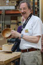 Photo: Gary Guenther talks about his freshly-oiled spalted birch bowl.