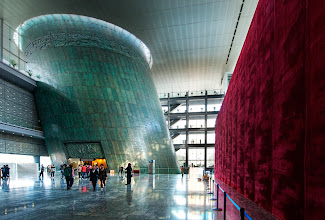 """Photo: The Capital Museum in Beijing  And look - another amazing super-structure in Beijing!  From what I understand, they have started bringing in more and more western architects to design innovative structures.  I'm not sure who the architect here is... but it's very well done.  See that giant red velvet wall to the right?  It's hiding a new display that's currently being built.  I've never seen such an elaborate """"under construction"""" wall!  from Trey Ratcliff at www.stuckincustoms.com"""