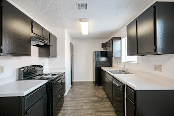 A1 floorplan fully-equipped kitchen with wood-style flooring, dark cabinets, and black appliances