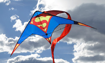 Photo: This is a composite of a cloud photo I had and one of the Superman kite photos taken in my backyard. The background has not been blurred.