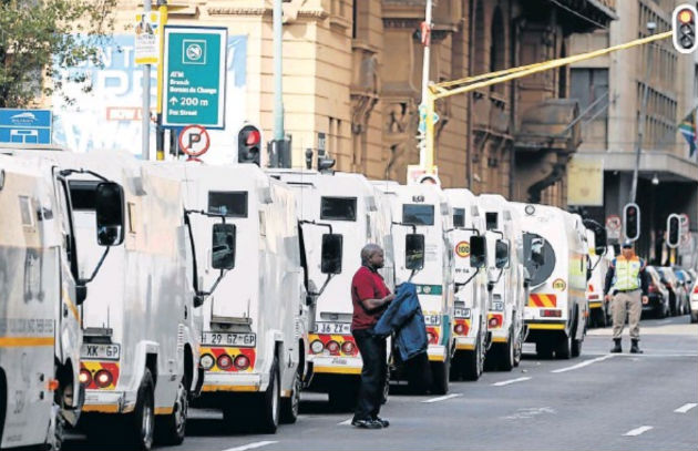 Cash-in-transit vehicles line up to join the protest by security industry employees in Johannesburg following a spate of deadly heists